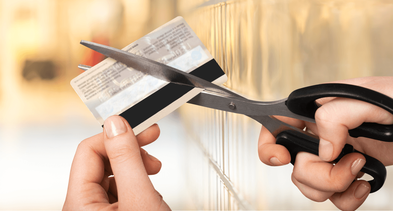 Money Talks: Tips From The Pros cutting credit card image
