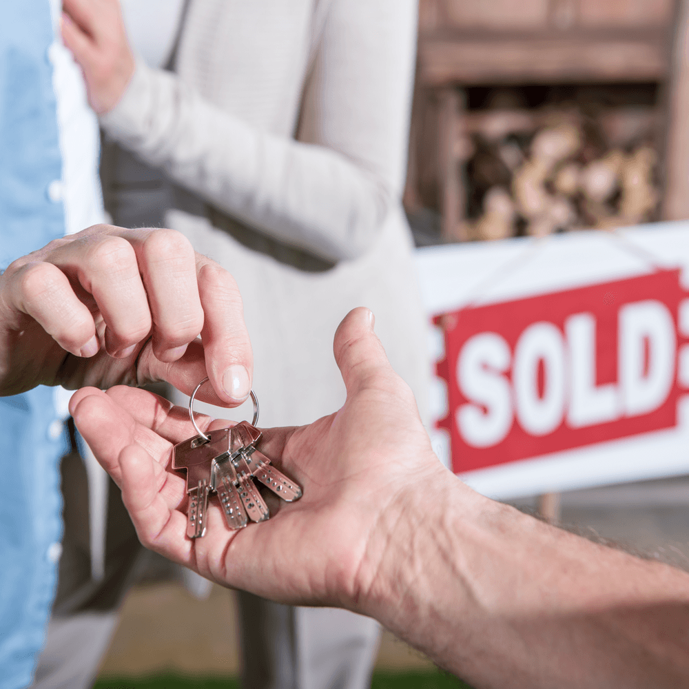 Why buying in a down market can be good for you giving keys to new owner image
