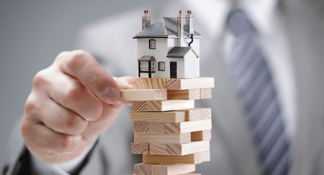 Why buying in a down market can be good for you house on block image