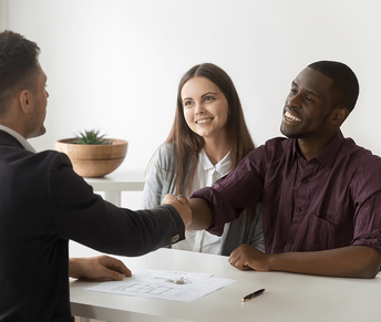 Home Buying For The First Time Getting a Mortgage Handshake Image