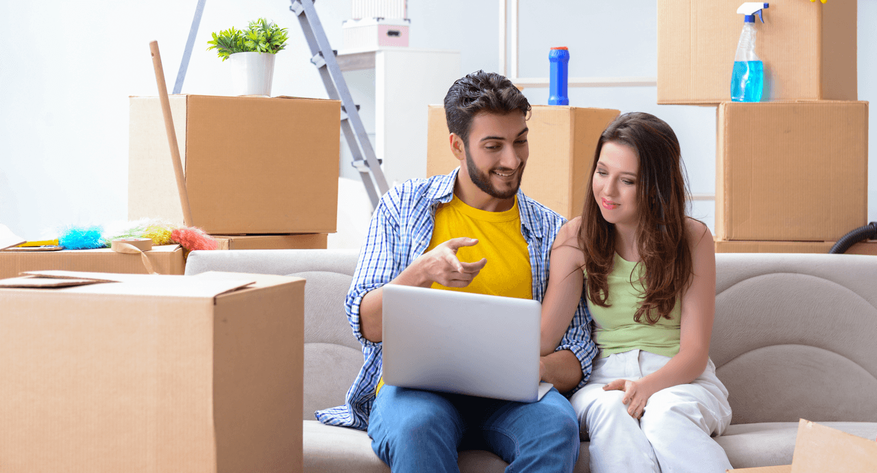 Home Buying For the First Time: Must-Have Home Items Couple Moving Image